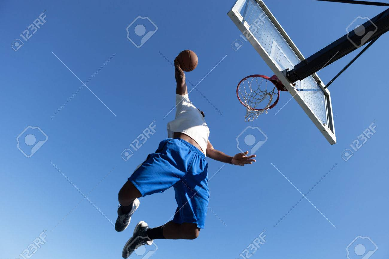 A young basketball player driving to the hoop with some fancy moves. Stock Photo - 22349841
