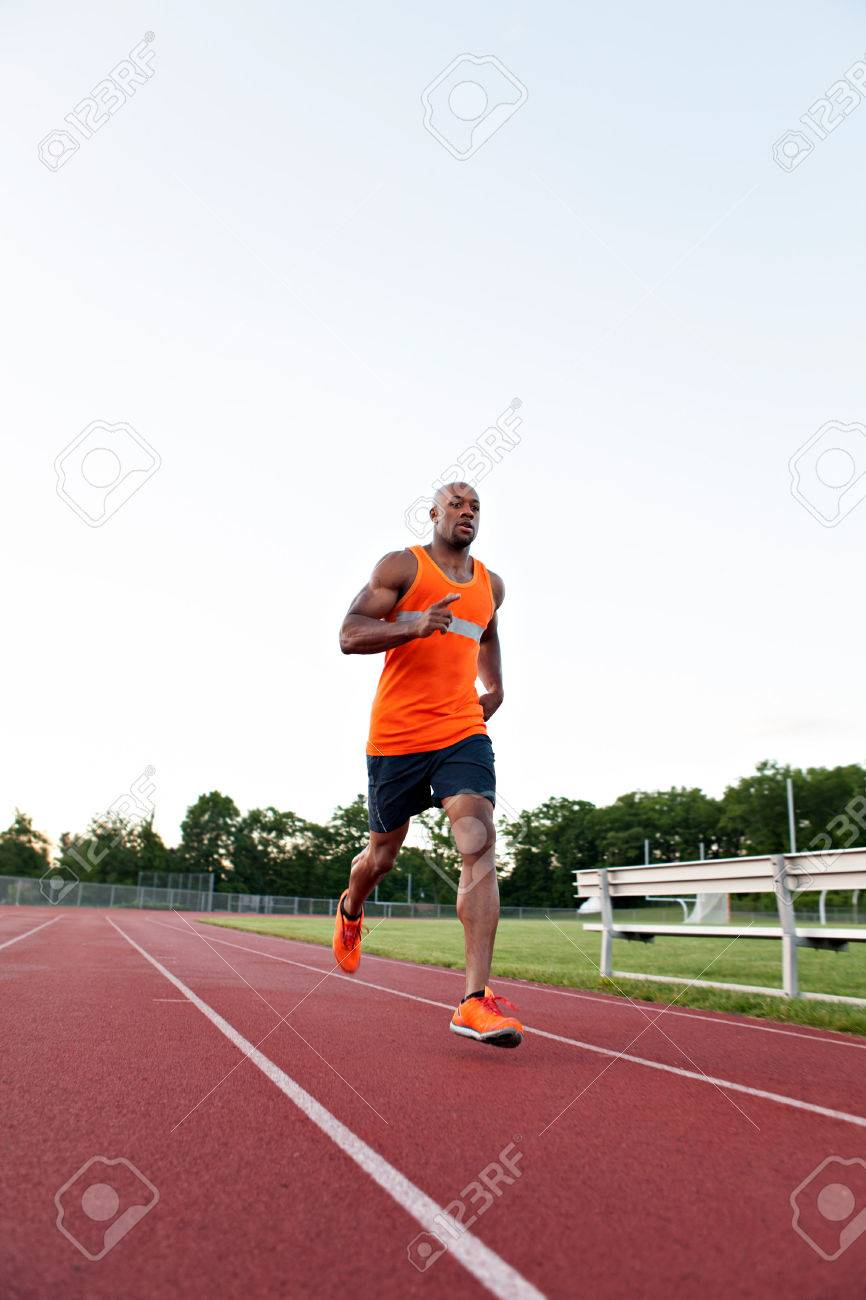 African American man in his 30s running at a sports track outdoors. Stock Photo - 29583438