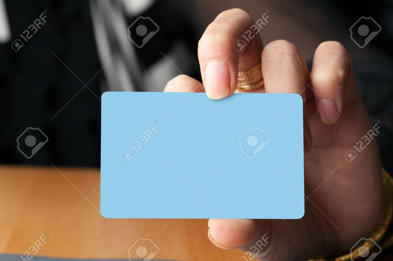 Female Hand Holding A Blank Business Card Gift Card Or Credit ...