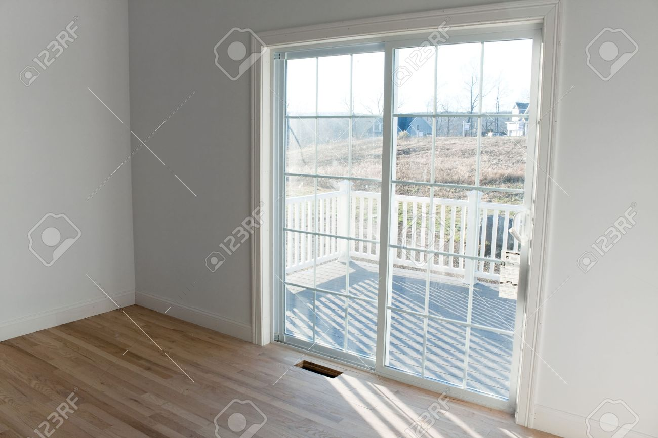 Modern home interior with sliding glass doors leading to a small porch. Stock Photo - 40852518