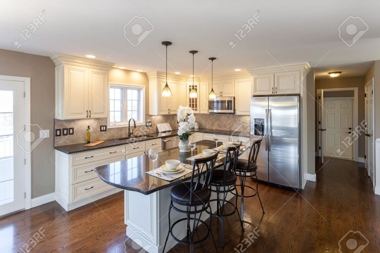 Beautiful staged kitchen room in a modern house with granite countertops and antique finished cabinets. Stock Photo - 56630501