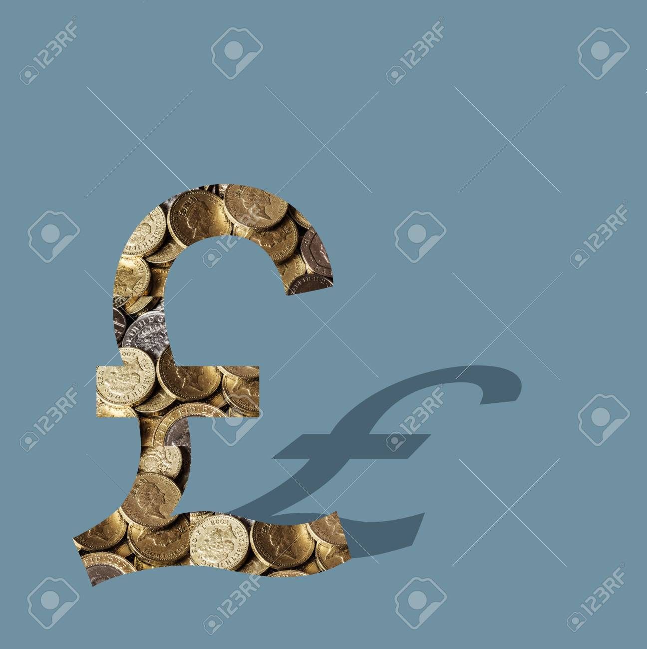 A Lot Of Shiny British Pound Coins Filling The Symbol Of Pound Stock