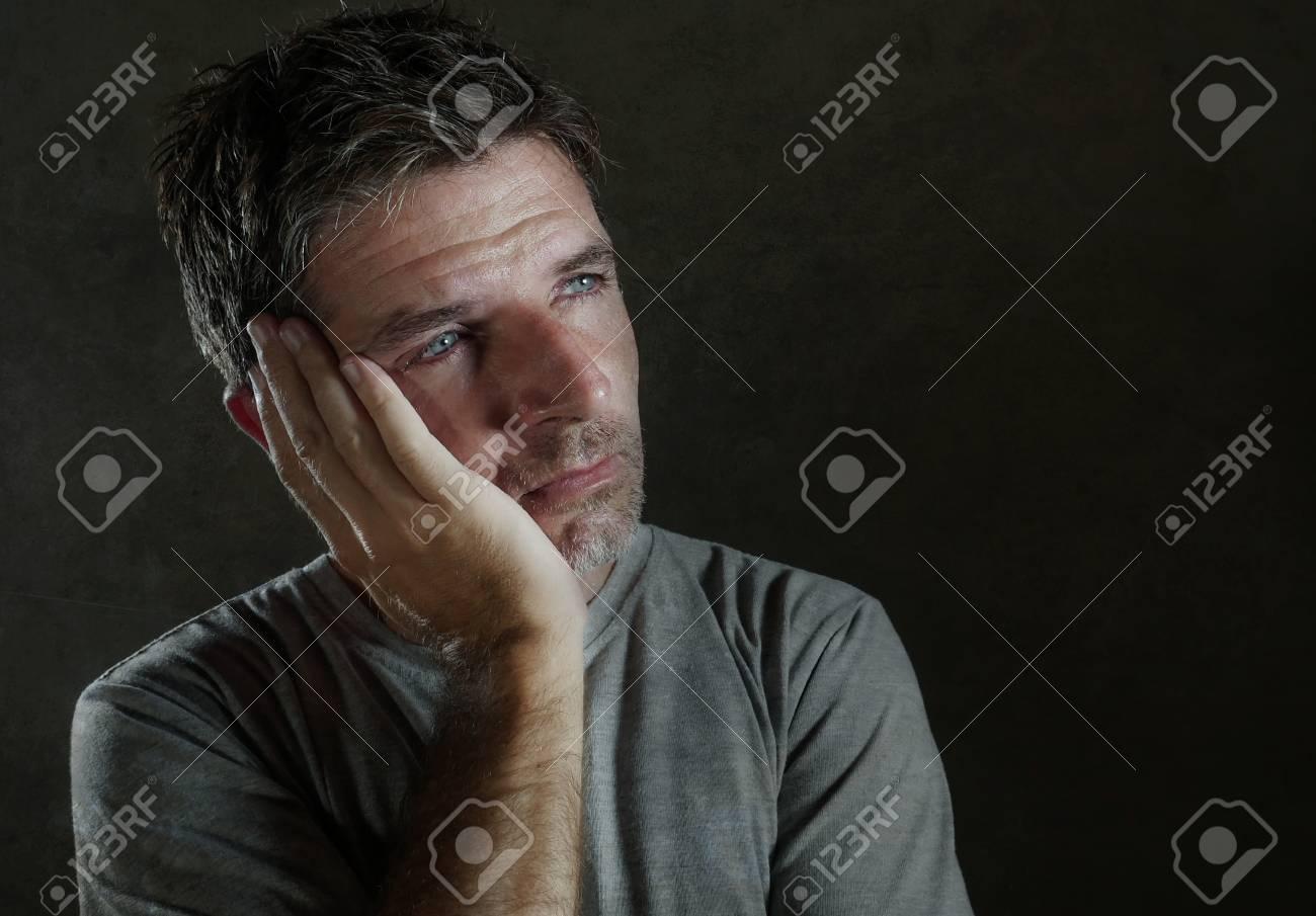 isolated dark background portrait of 30s to 40s sad and depressed