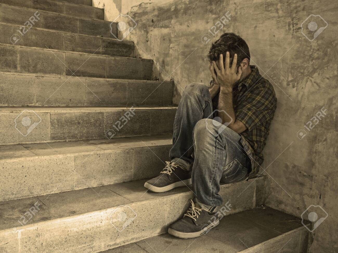 Dramatic Lifestyle Portrait Of Young Depressed And Sad Man Sitting Stock Photo Picture And Royalty Free Image Image 128822497