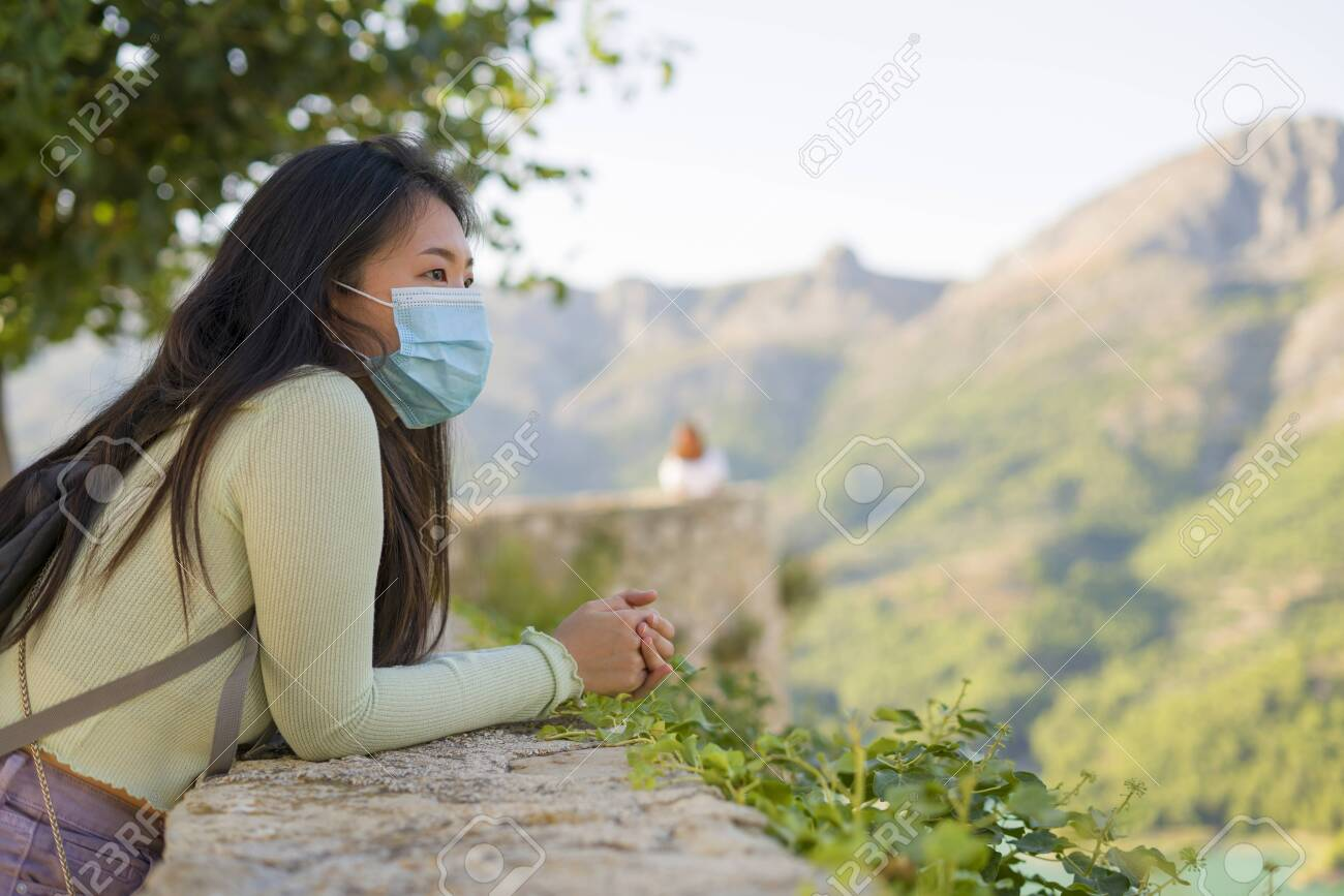 lifestyle portrait of young happy and cheerful Asian Chinese tourist woman visiting Spain during Summer holidays travel hiking and enjoying nature from beautiful viewpoint - 153962951