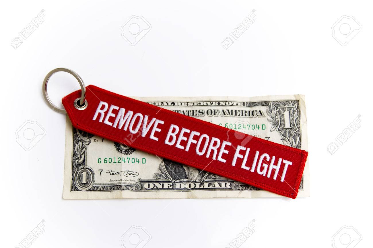 Vor Dem Flug Entfernen Label über Einen Dollar Ausdrücken