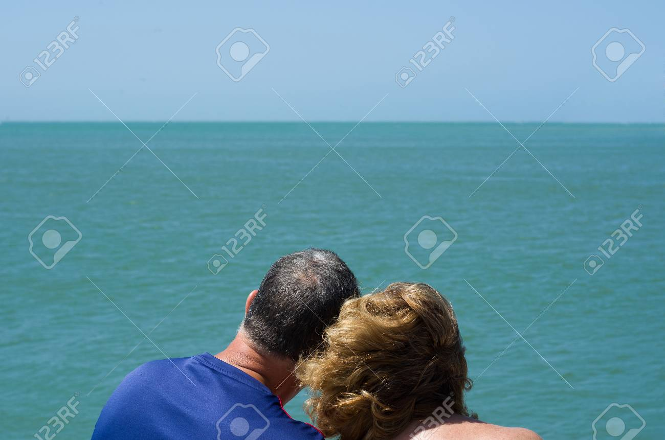 Old couple looking at the horizon, beach, love. - 97418058