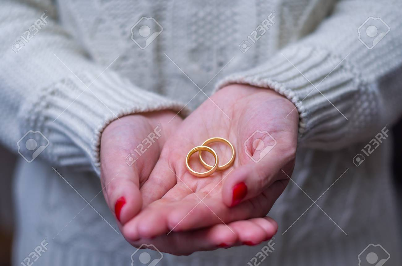 Great Concept Of Divorce Woman Hand With Two Gold Wedding Rings ...