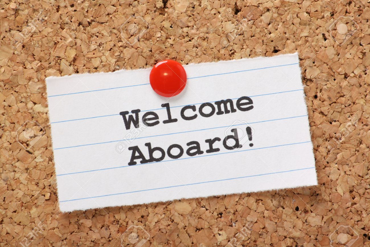 The Phrase Welcome Aboard Typed Onto A Scrap Of Lined Paper Stock
