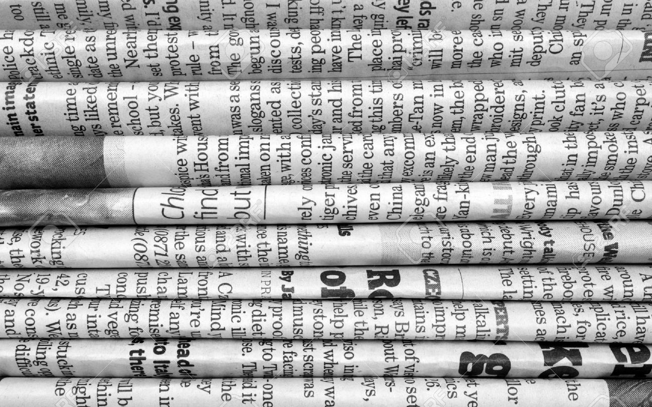 A Black And White Background Of English Language Newspapers Stacked Folded In Horizontal Position