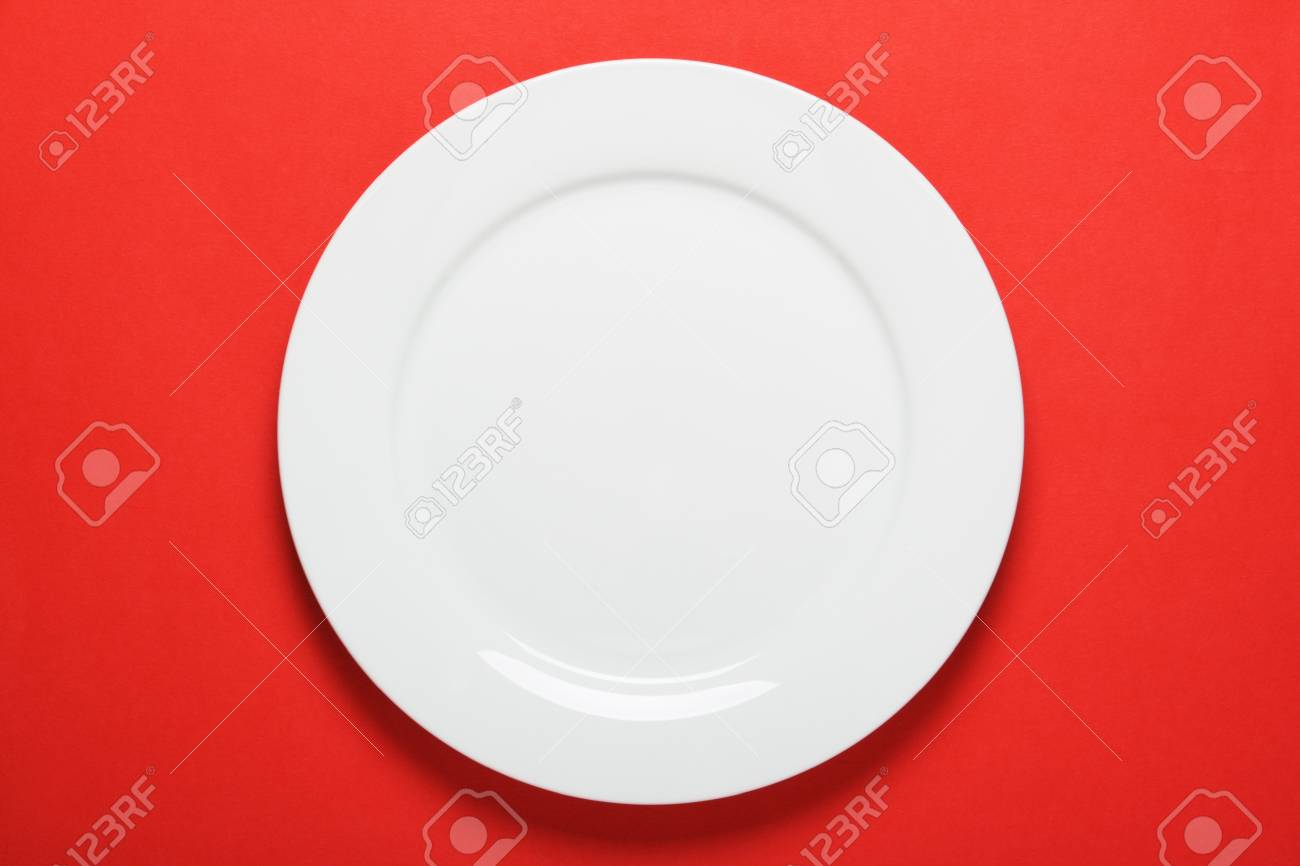 A Plain White Dinner Plate On A Bright Red Paper Background Stock Photo Picture And Royalty Free Image Image 30113291