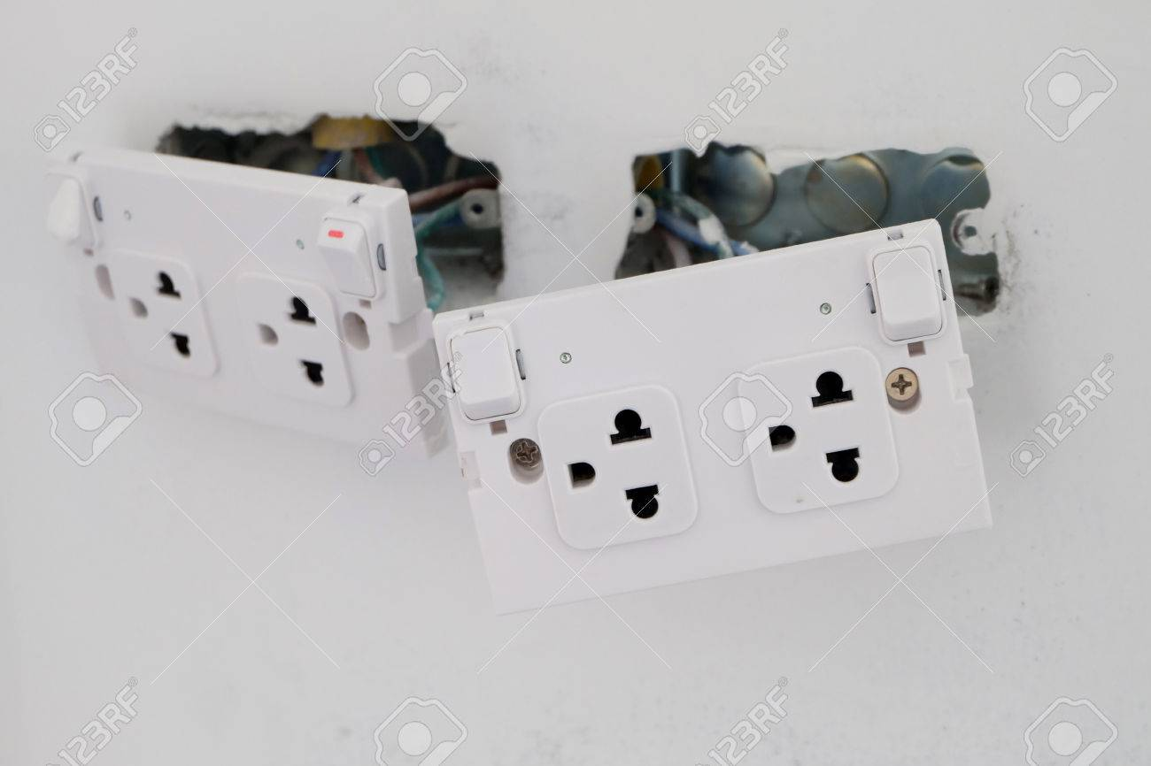 Electric Sockets Installation In White Walls At House Construction Site Stock Photo 58195611