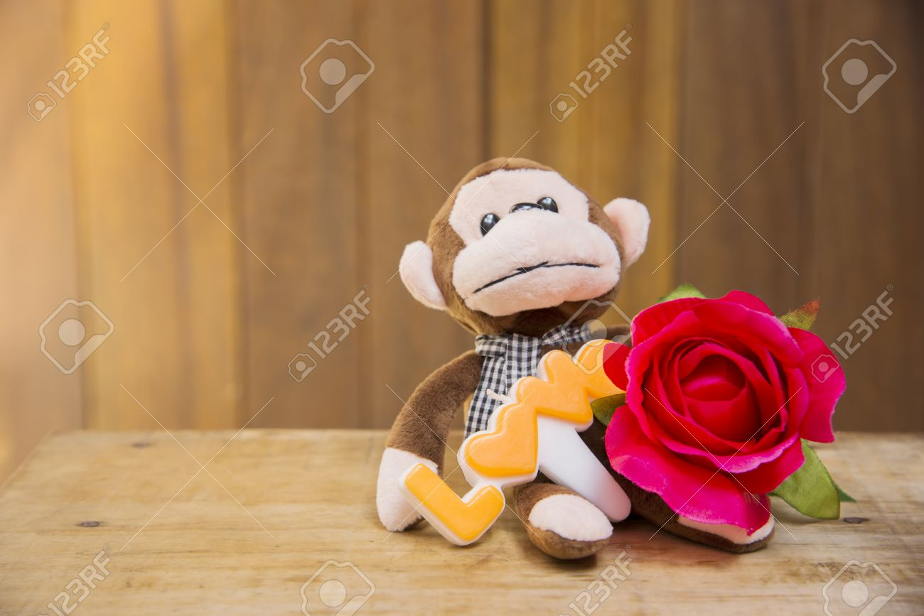 Signs Of Love With Stuffed Monkeys And Flowers Blurred Abstract ...