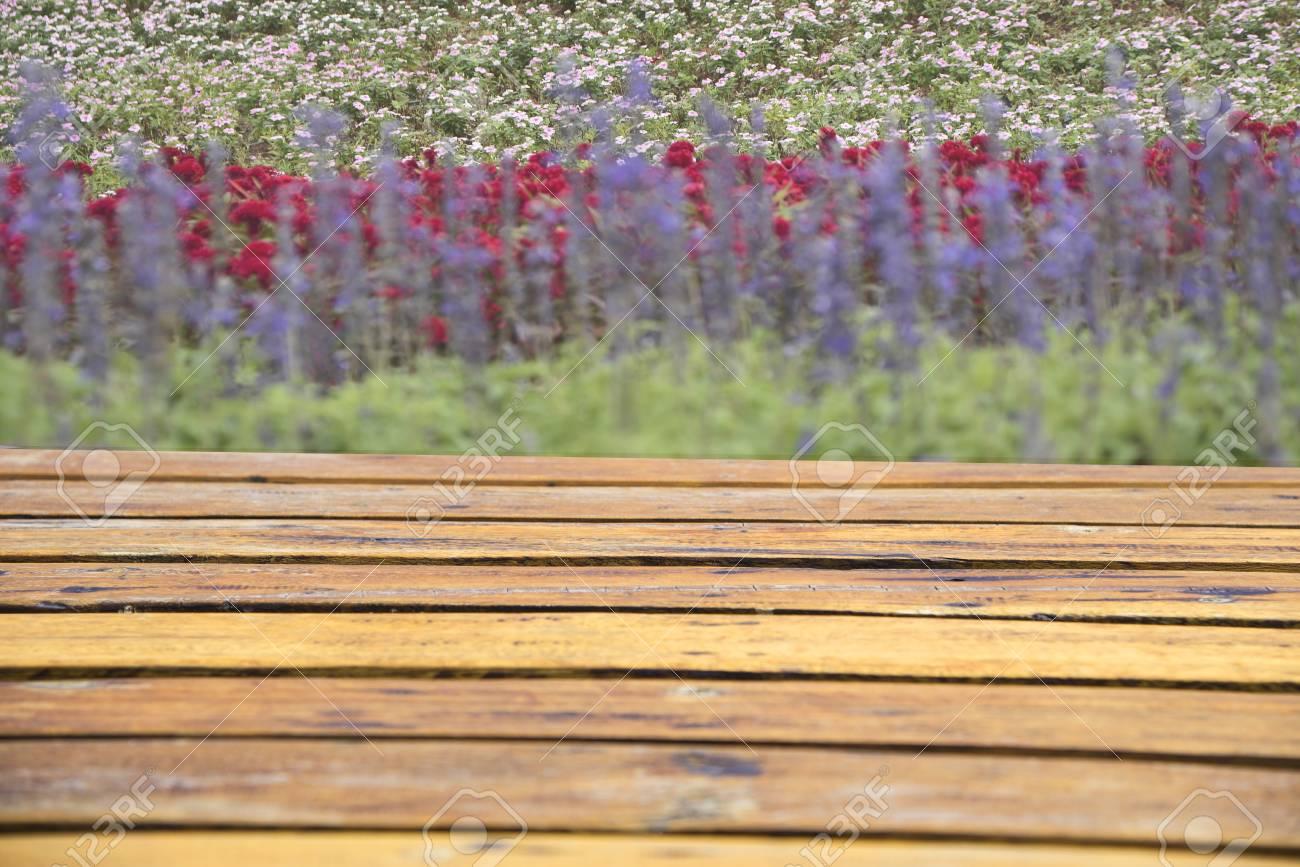 Planks on the floor behind the beautiful flowers for display stock planks on the floor behind the beautiful flowers for display or editing products stock photo izmirmasajfo