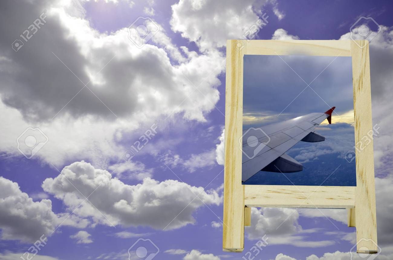 Pictures wing aircraft in a wooden box background blur sky background