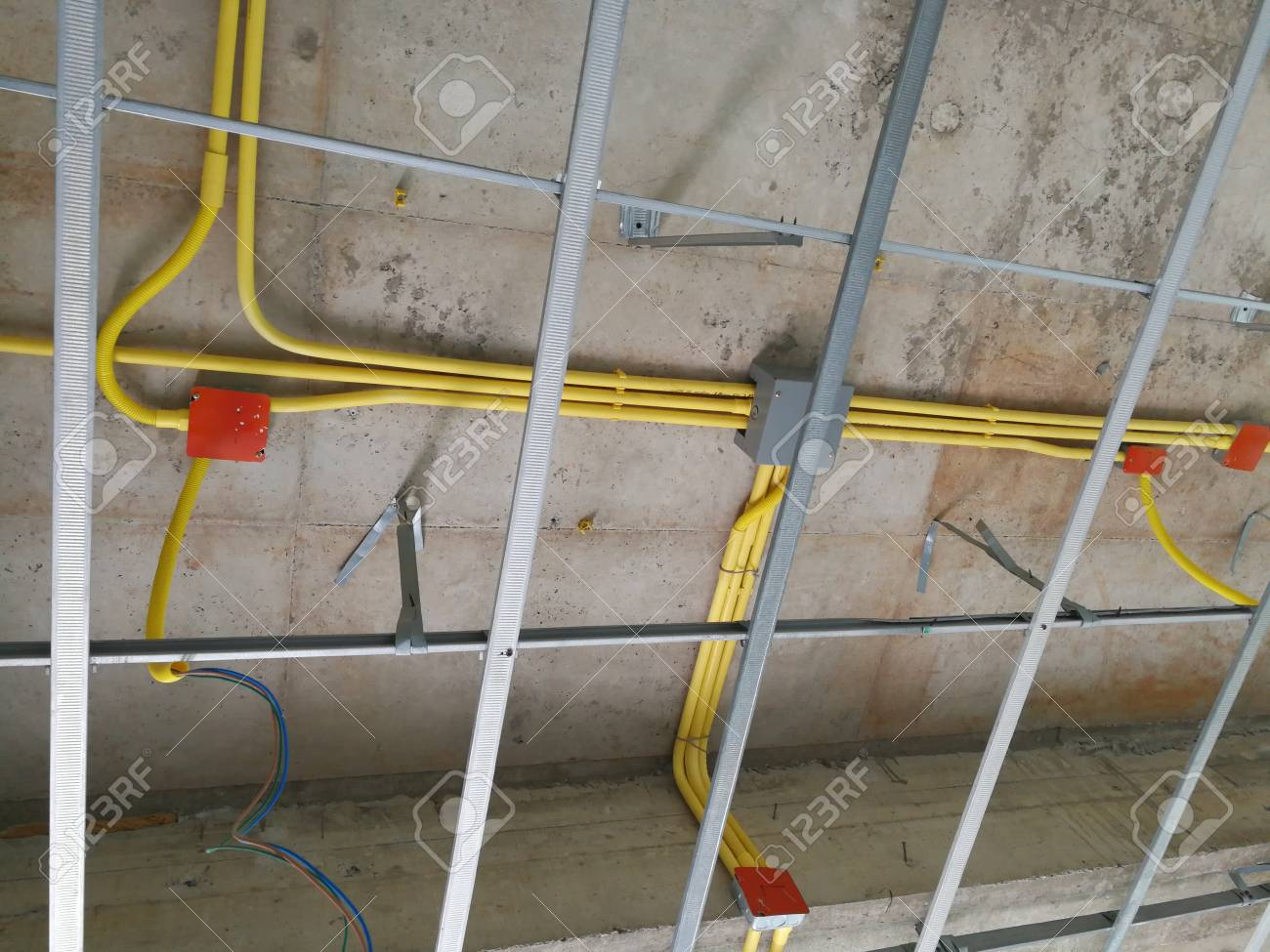 Ceiling under construction and home wiring duct Stock Photo - 84610653