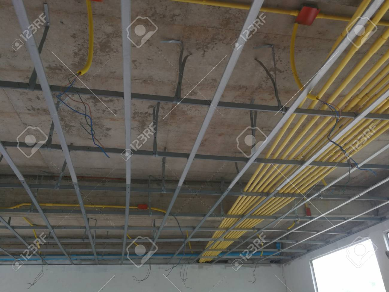 ceiling under construction and home wiring duct stock photo - 84706154