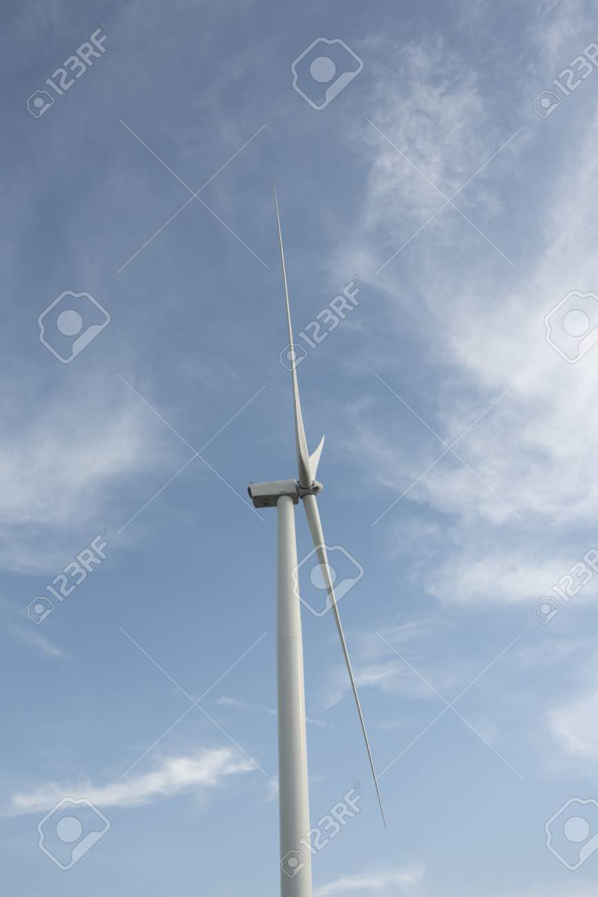 Wind Turbine With Cloudy Sky As Background Or Wallpaper