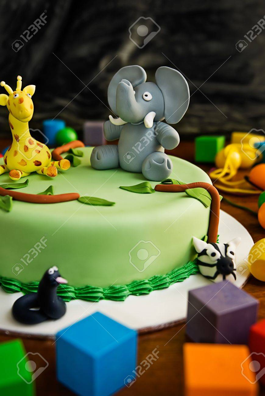 Enjoyable Jungle Themed Birthday Cake With An Elephant And Giraffe On Top Funny Birthday Cards Online Chimdamsfinfo