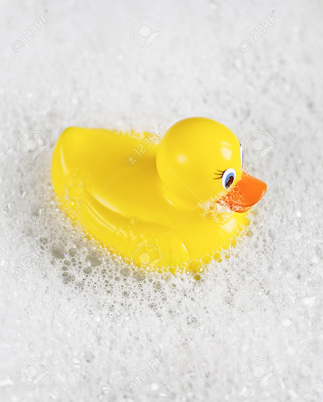 Bathtime Fun With A Yellow Rubber Ducky In A Bathtub Full Of.. Stock ...