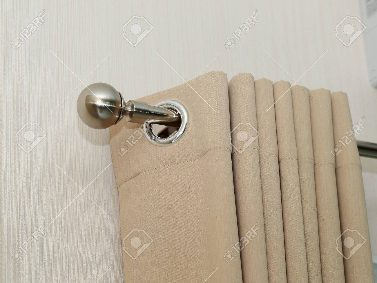 Cream Colored Curtains In Steel Rail Close Up View Stock Photo   46078041