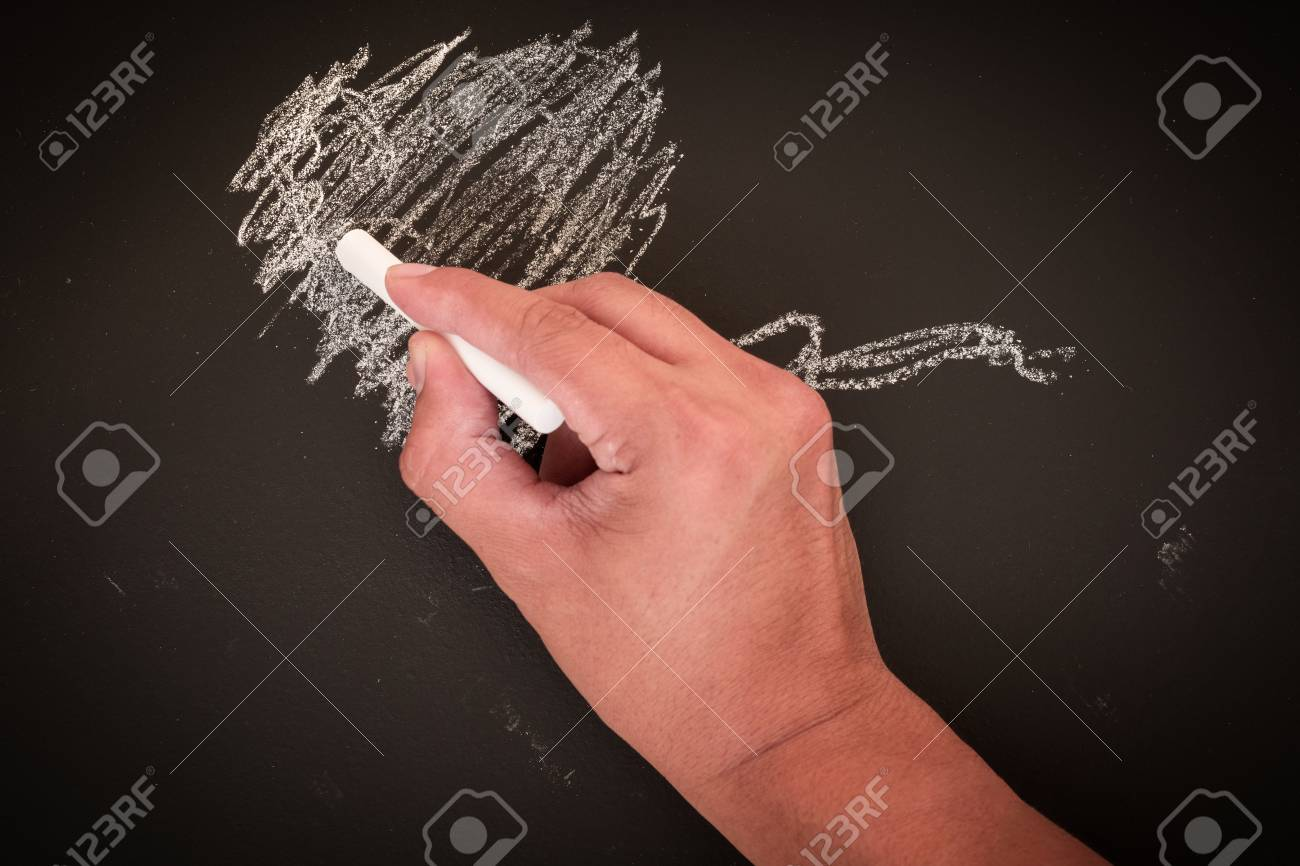 Hand To Draw Something On Blackboard With Chalk Stock Photo Picture