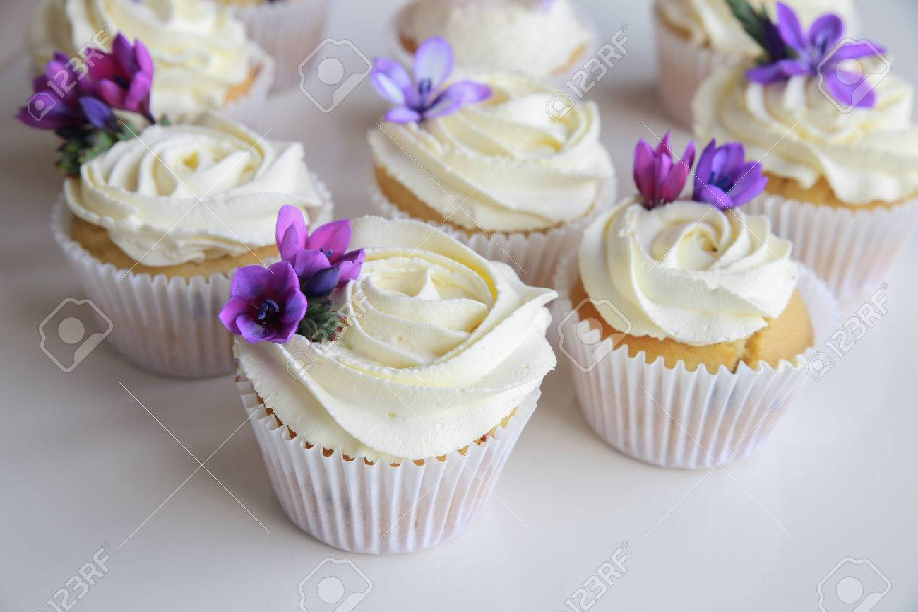Edible Purple Freesia Flowers On Vanilla Cupcakes With Whipped Stock Photo Picture And Royalty Free Image Image 47113109