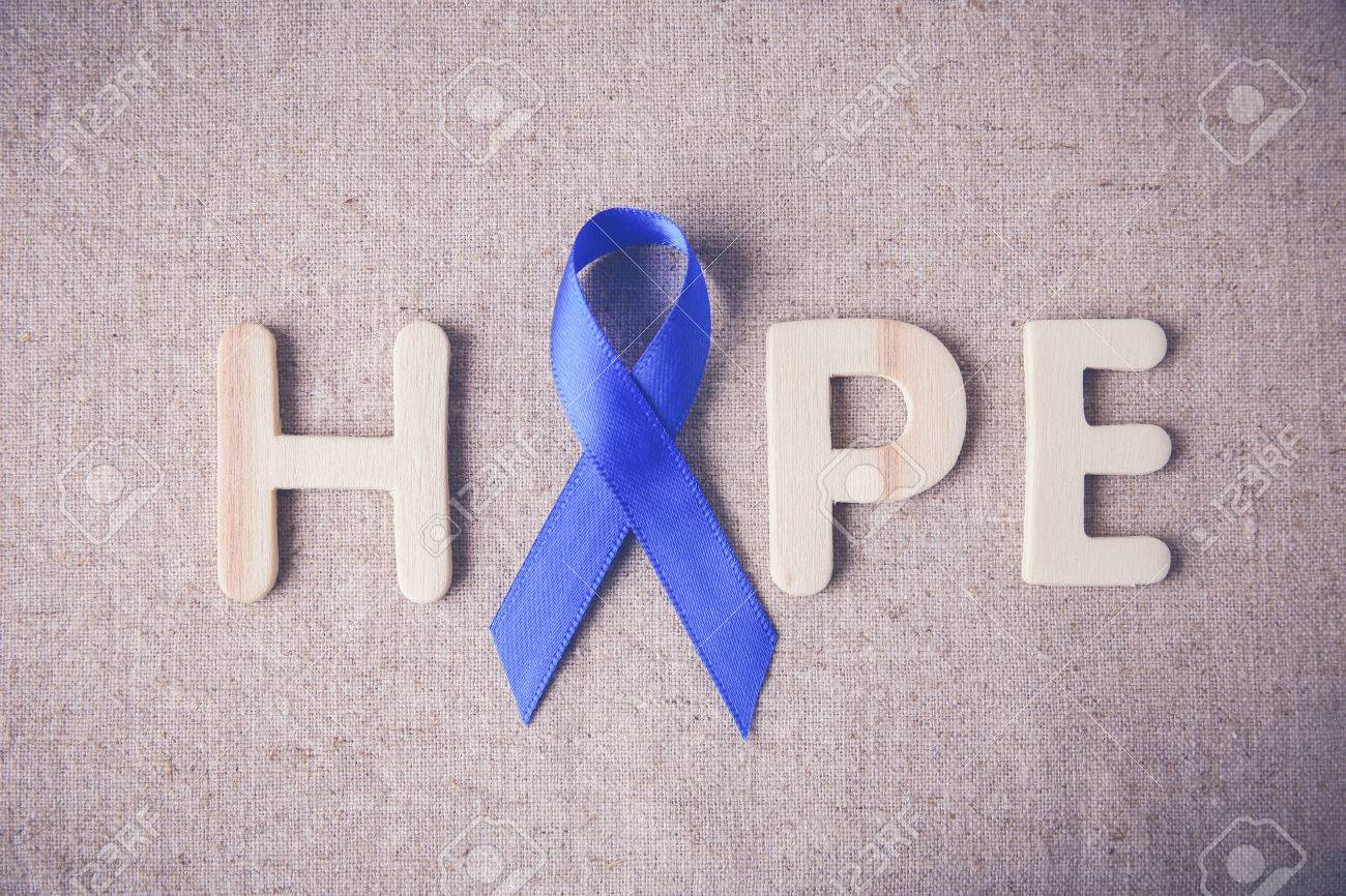 Blue Ribbon With Hope Word Toning Background Colon Cancer Stock
