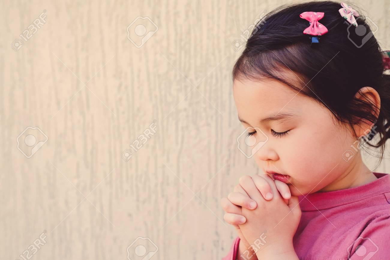 Little Multiethnic Girl Praying Kid Child Pray Concept Stock Photo
