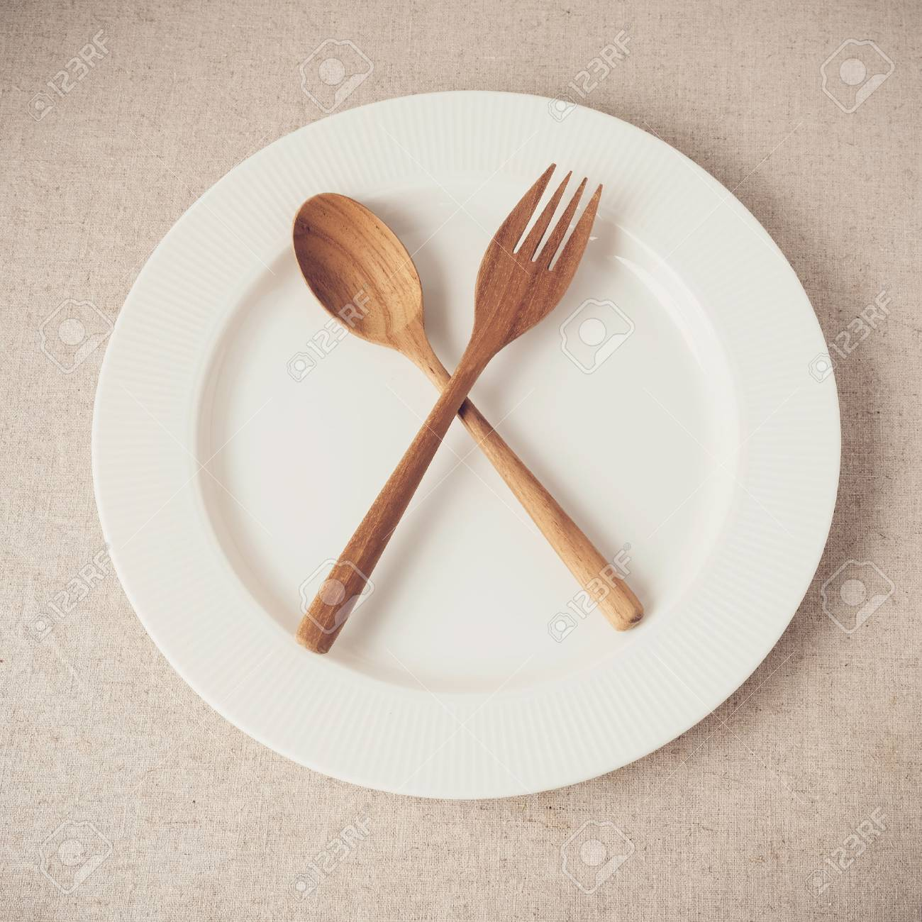 white plate with spoon and fork, Intermittent fasting concept,