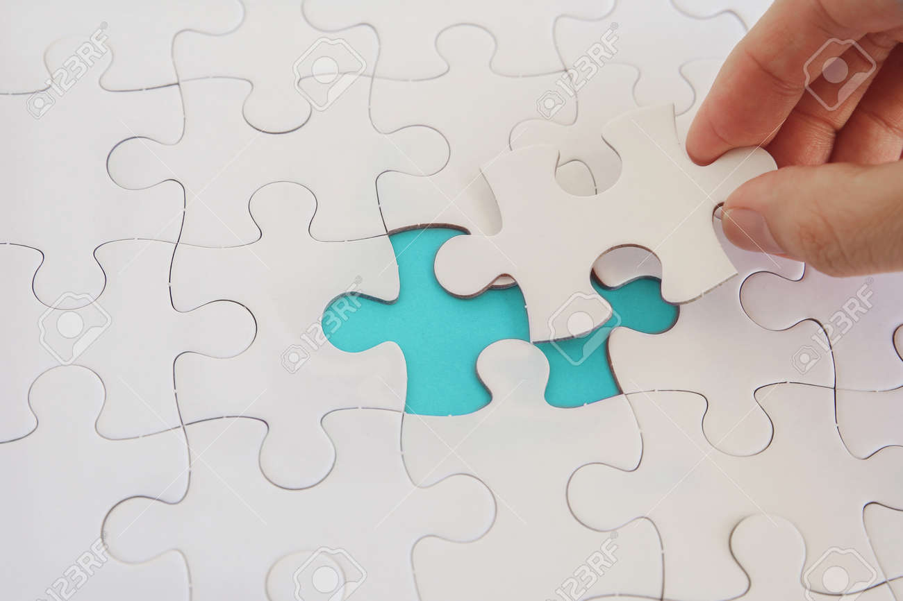 Hands with jigsaw puzzle pieces, Business strategy planning, Alzheimer's disease, Autism and mental health concept - 156965994