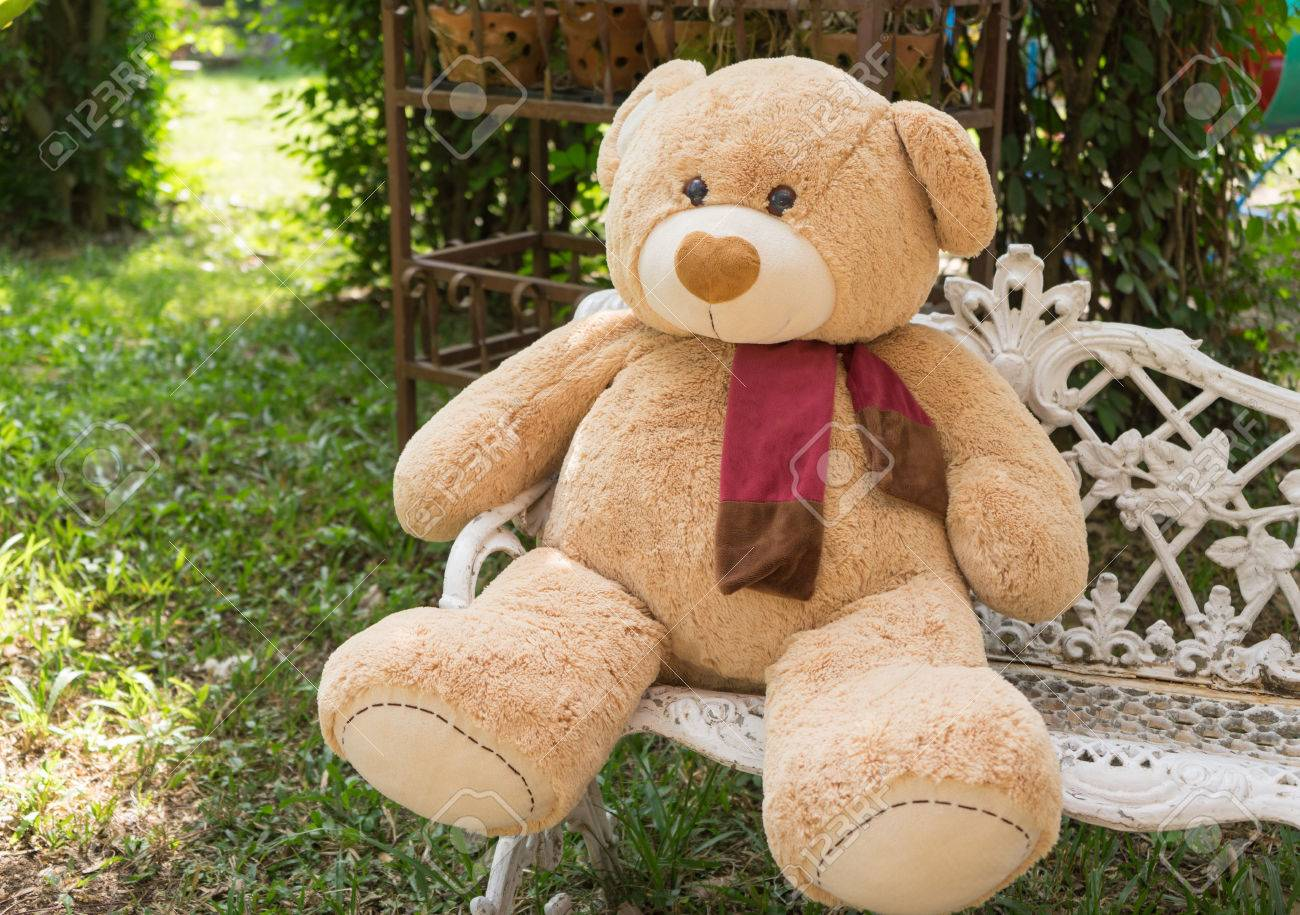 Big bear doll sit on the chair in garden stock photo picture and big bear doll sit on the chair in garden stock photo 50119303 publicscrutiny Gallery