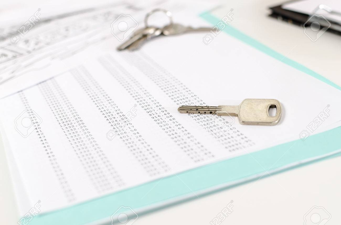house keys on an amortization schedule closeup stock photo picture