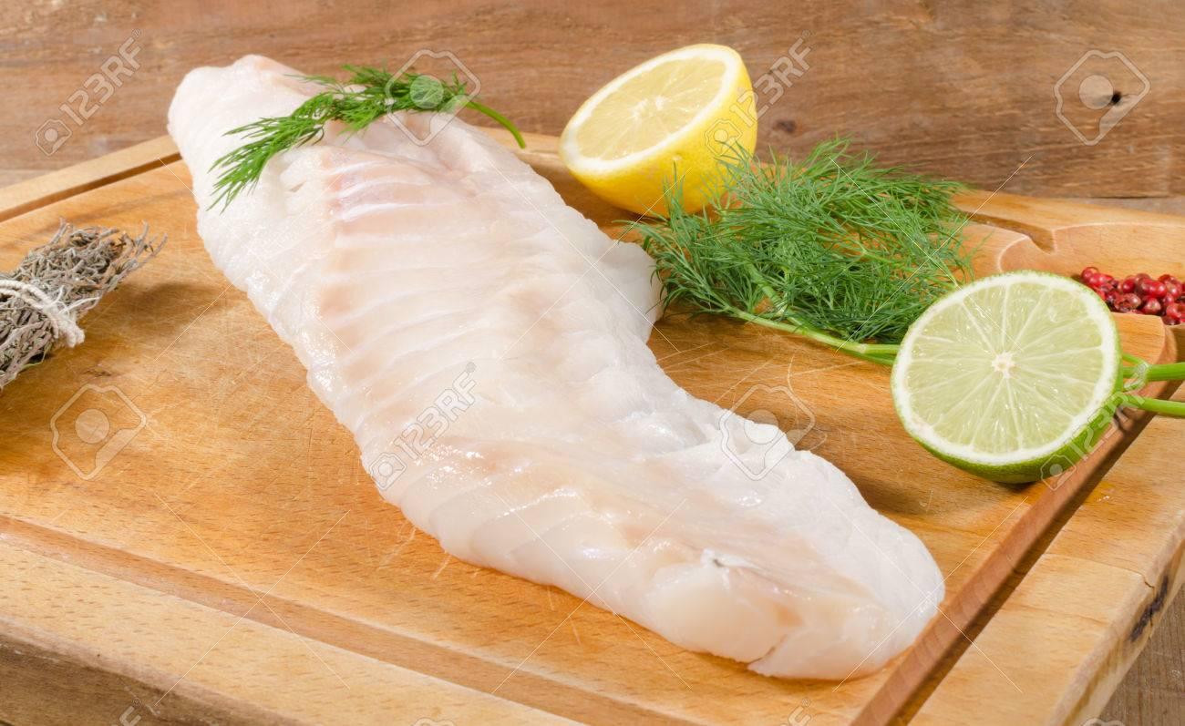 Cod fillet on wooden board - 42963433