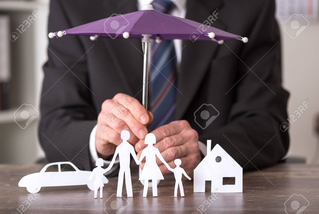 Concept of insurance with umbrella over a house, a car and a family - 53357629