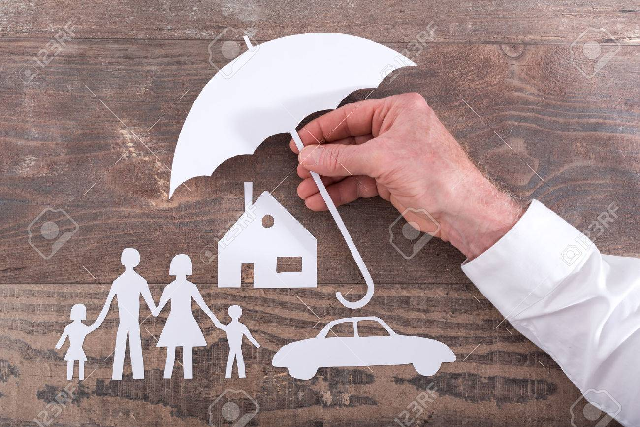 House, car and family protected with an umbrella - insurance concept - 61150733