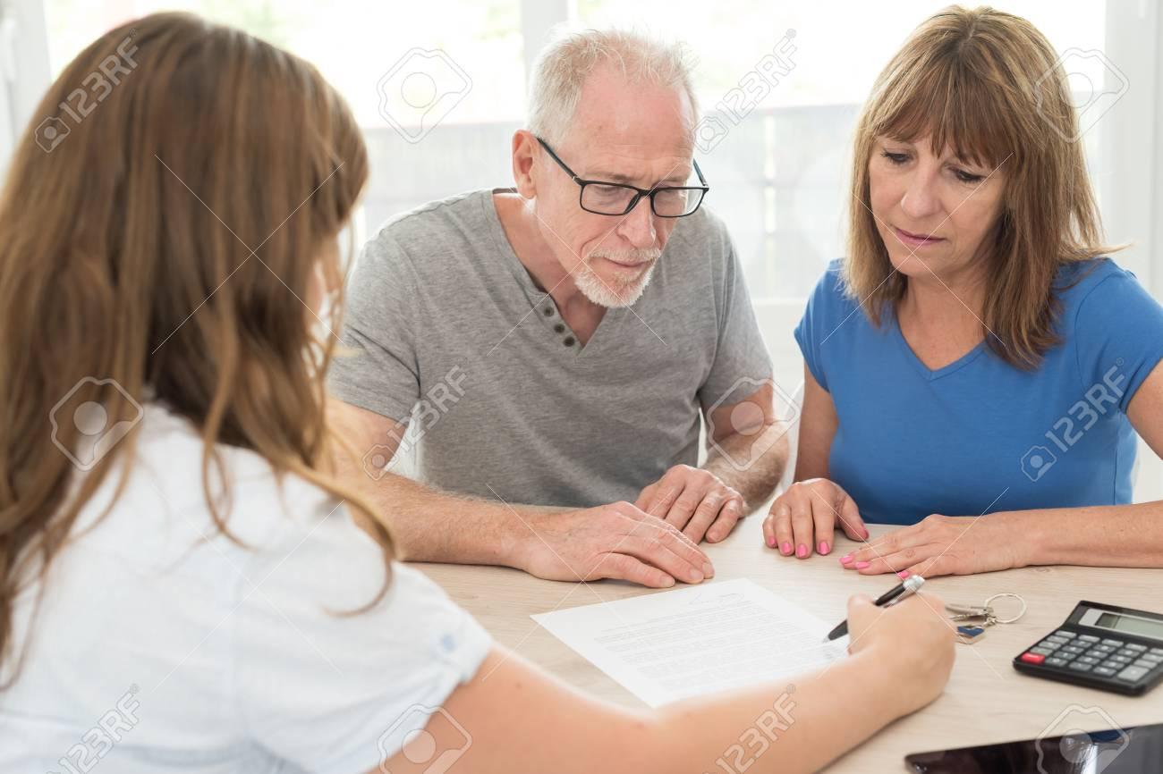 Senior couple meeting financial adviser for investment - 87657339