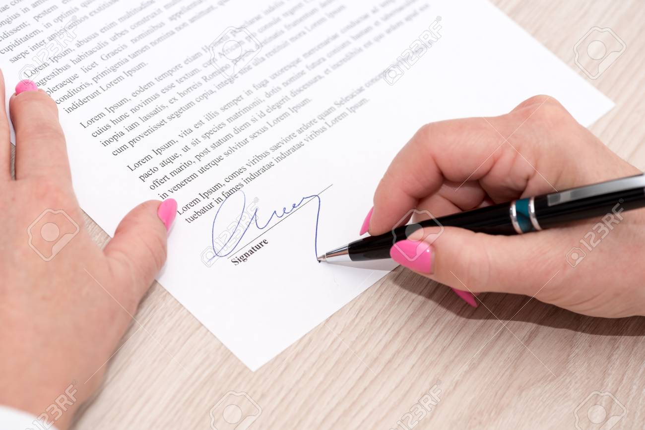 Woman Signing A Legal Document Stock Photo Picture And Royalty Free - Signing legal documents