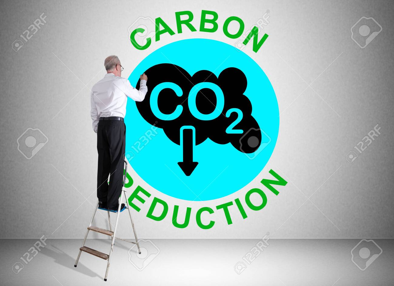 Man on a ladder drawing carbon reduction concept on a wall - 155039891