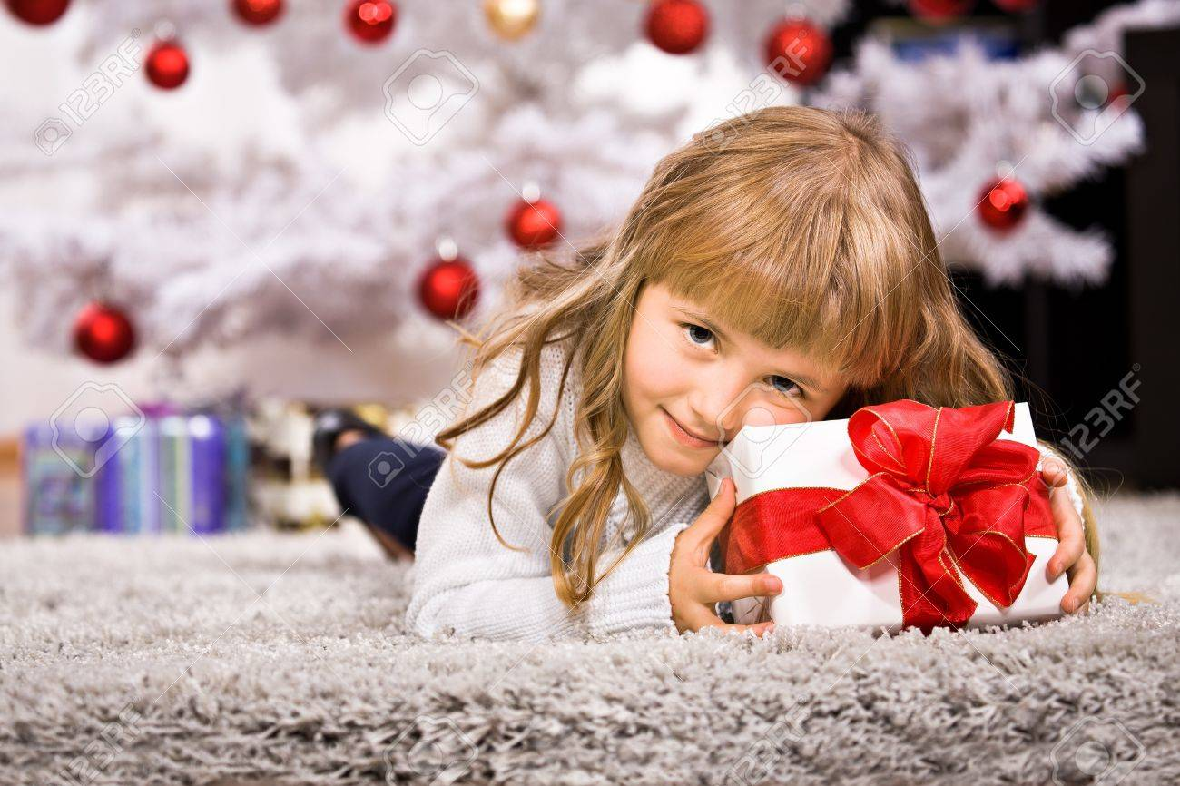 a little girl geting the Christmas gift Stock Photo - 10927570