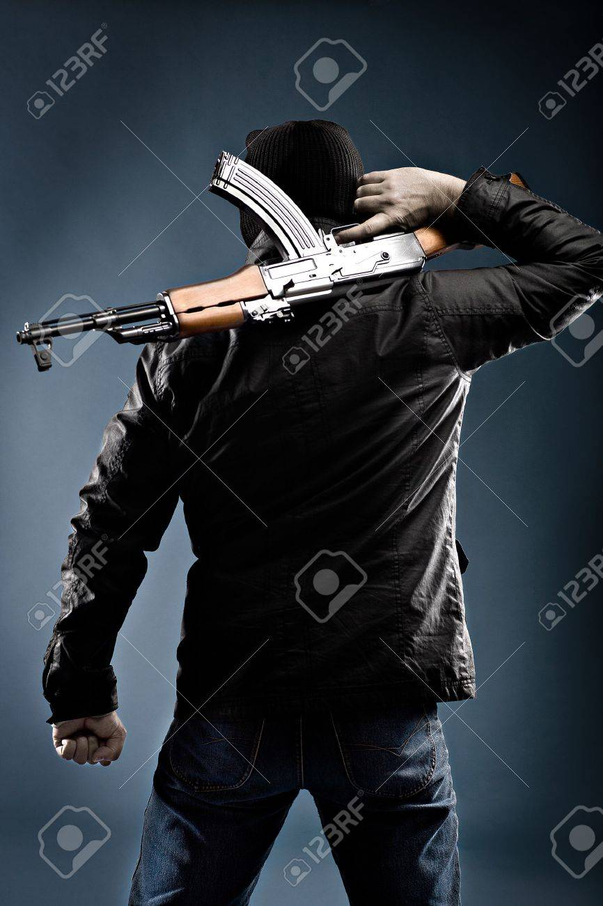 masked terrorist with a kalashnikov submachine gun - 11354645