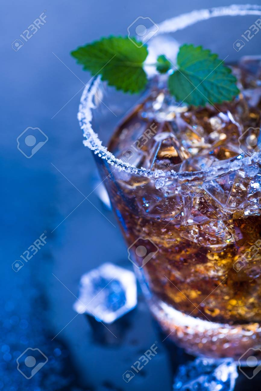 a glas with a rum, ice and lime cocktail Stock Photo - 12871728