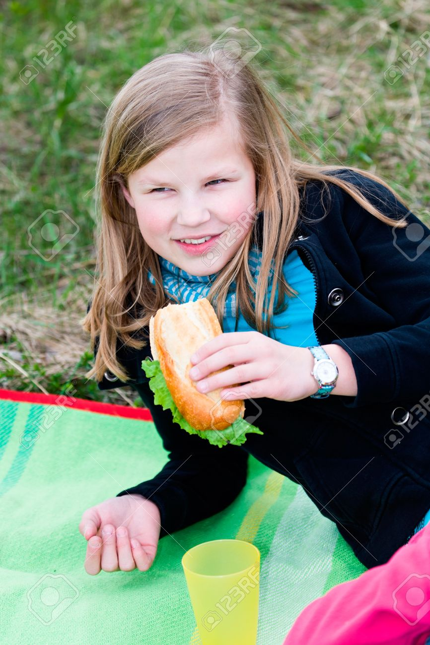 Teeny Girl With Sandwich At Picknick Stock Photo, Picture And ...
