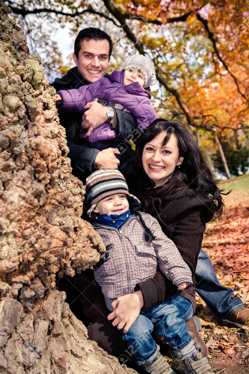 portrait of a young family in the autumn park Stock Photo - 16193930