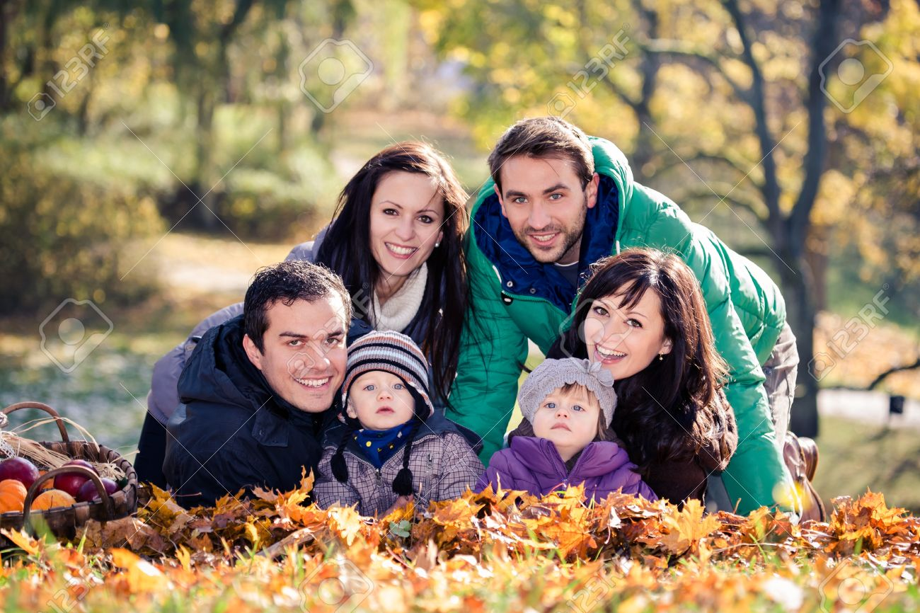 portrait of two young families in the autumn park Stock Photo - 17900566