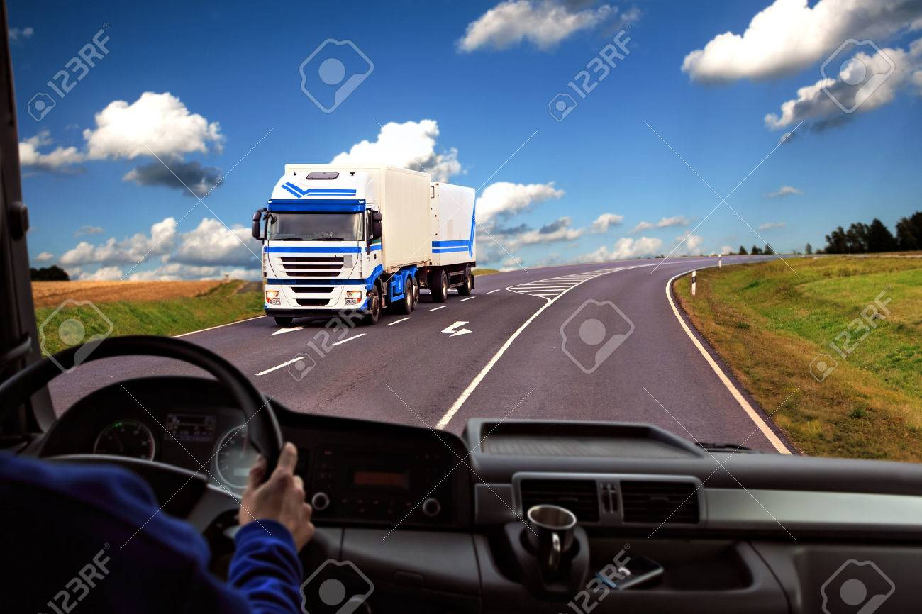driver view from the cockpit of a truck on the road - 28909350