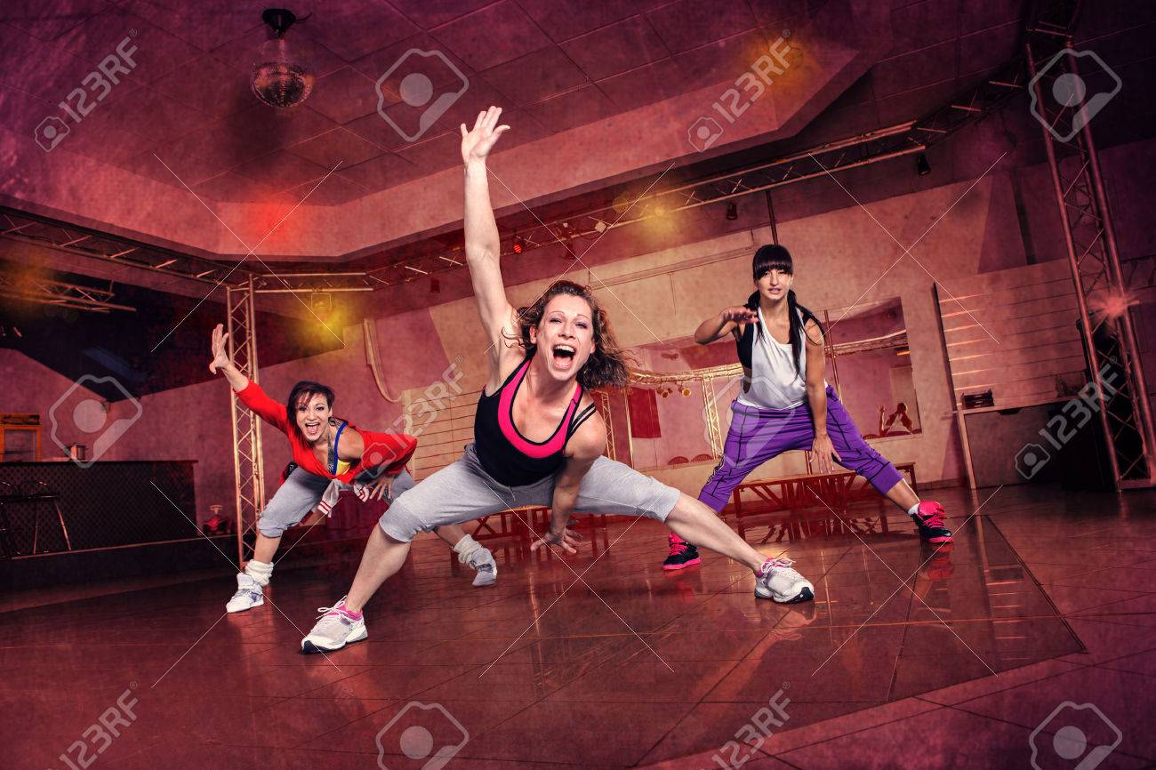 group of women in sport dress at fitness dance exercise or aerobics - 42503904