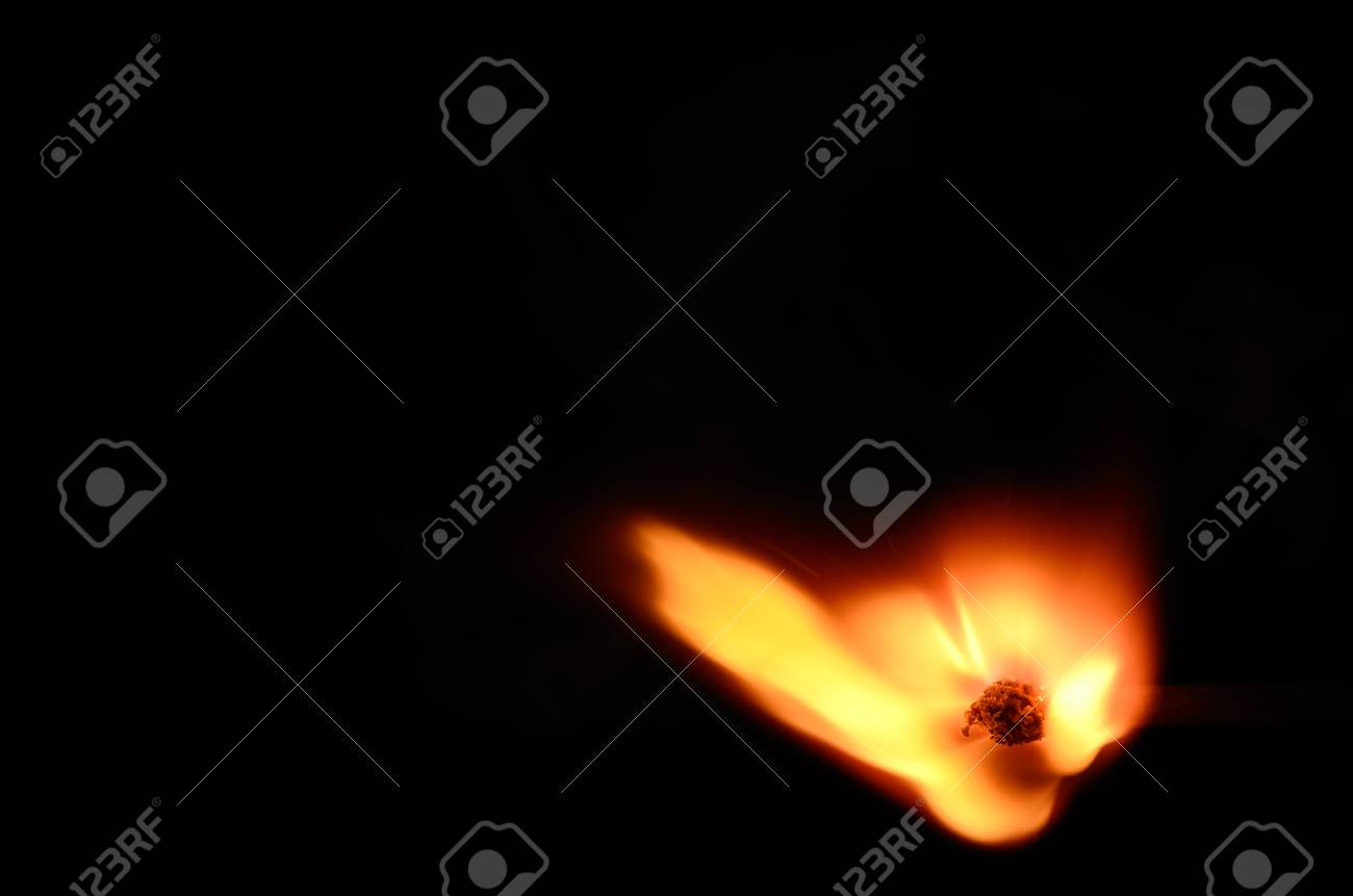 ignited match with hot flame on black Stock Photo - 28274179