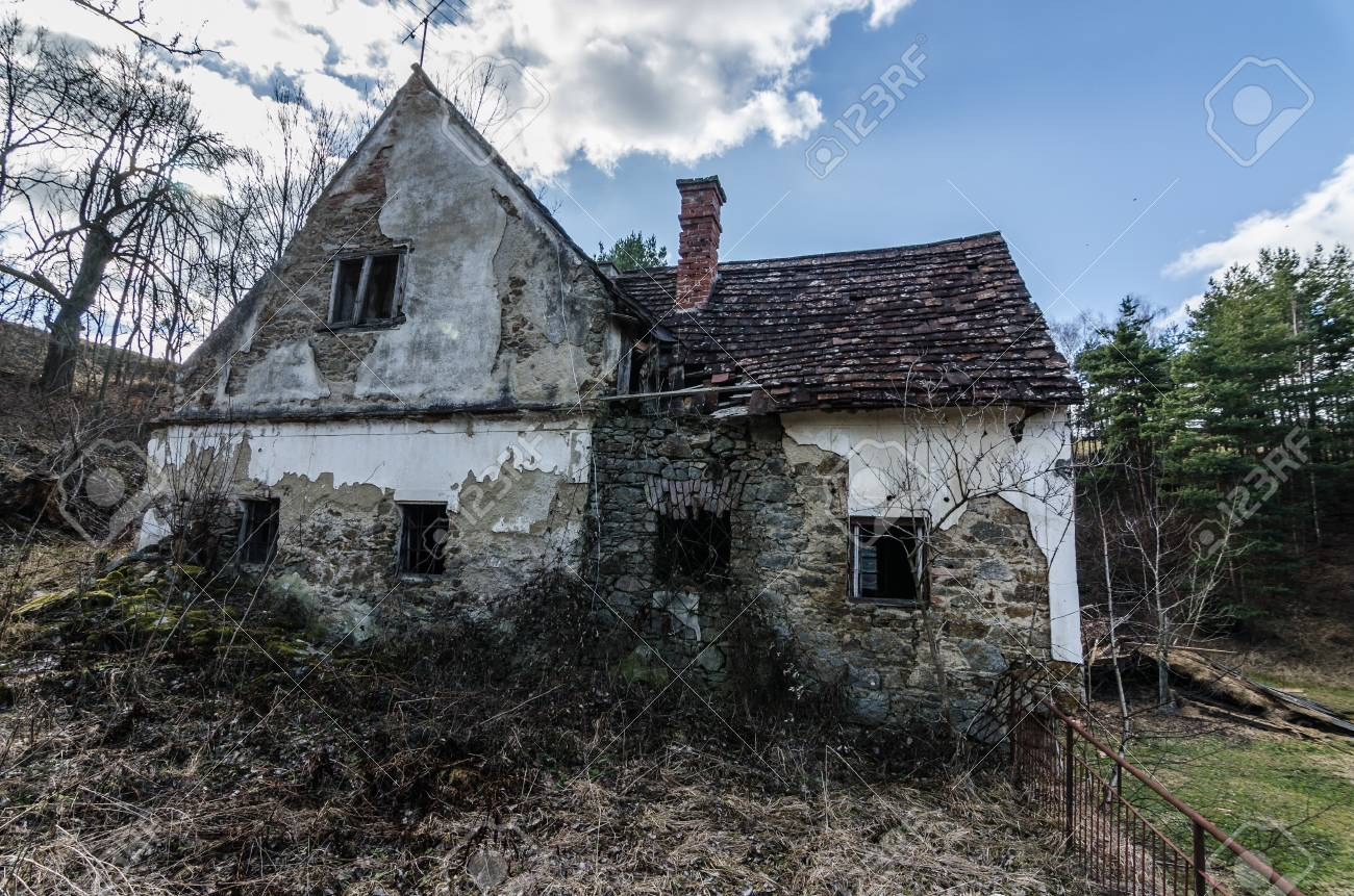 old abandoned farmhouse in the wood and mountain