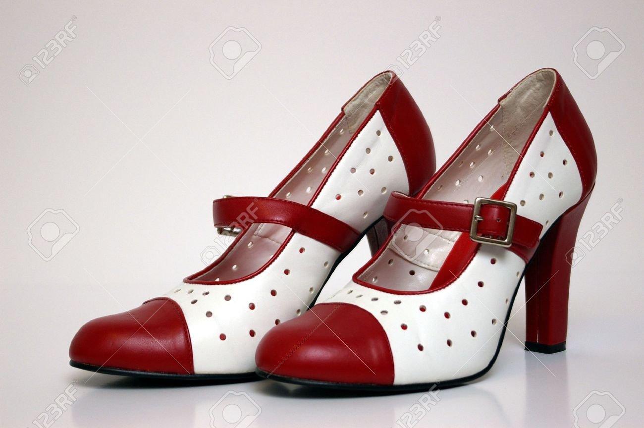 A side view of a pair of red and white high heels on white. Stock Photo - 4867898